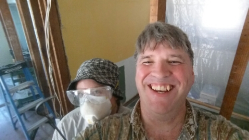 Me and my lovely wife (she is even lovelier without the mask) working on our house. This is not just painting a room, this is reconstructing the rooms to our specs and then getting them ready to paint.